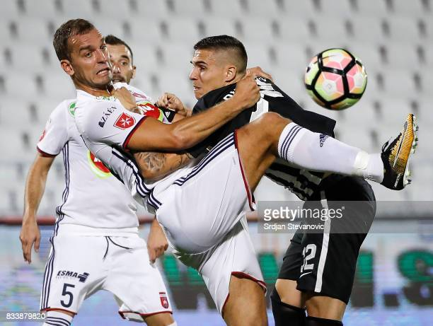Uros Djurdjevic of Partizan competes for the ball against Roland Juhasz of Videoton during the UEFA Europa League Qualifying PlayOffs round first leg...