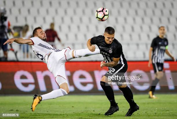 Uros Djurdjevic of Partizan in action against Attila Fioala of Videoton during the UEFA Europa League Qualifying PlayOffs round first leg match...