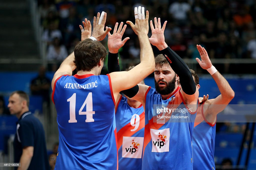 Uros Kovacevic and Aleksandar Atanasijevic of Serbia celebrate during the FIVB World League Group 1 Finals semi-final match between the United States and Serbia at Maracanazinho on July 18, 2015 in Rio de Janeiro, Brazil.