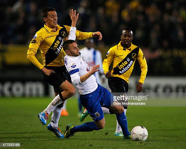 Uros Matic and Elson Hooi of NAC tackle Rochdi Achenteh of Vitesse during the Eredivisie match between NAC Breda and Vitesse at the Rat Verlegh...