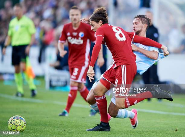 Uros Matic of FC Copenhagen and Christian Kohler of FC Helsingor compete for the ball during the Danish Alka Superliga match between FC Helsingor and...