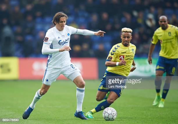 Uros Matic of FC Copenhagen and Hany Mukhtar of Brondby IF compete for the ball during the Danish Alka Superliga match between Brondby IF and FC...