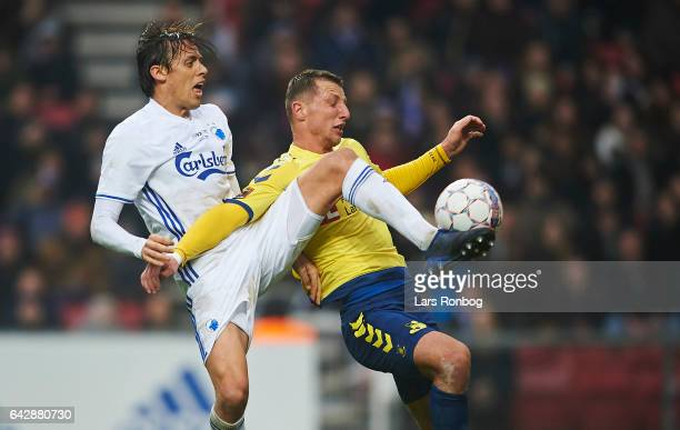 Uros Matic of FC Copenhagen and Kamil Wilczek of Brondby IF compete for the ball during the Danish Alka Superliga match between FC Copenhagen and...
