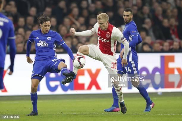 Uros Matic of FC Copenhagen Donny van de Beek of Ajax Youssef Toutouh of FC Copenhagenduring the UEFA Europa League round of 32 match between Ajax...