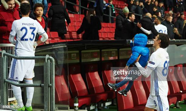 Uros Matic of FC Copenhagen in funtime with a kid after the UEFA Europa League Round of 16 First Leg match between FC Copenhagen and Ajax Amsterdam...