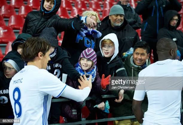 Uros Matic of FC Copenhagen Jores Okore of FC Copenhagen and fans after the Danish Alka Superliga match between FC Copenhagen and Esbjerg fB at Telia...