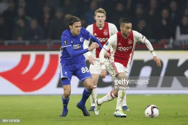 Uros Matic of FC Copenhagen Matthijs de Ligt of Ajax Hakim Ziyech of Ajaxduring the UEFA Europa League round of 32 match between Ajax Amsterdam and...