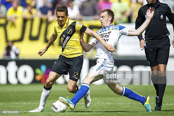 Uros Matic of NAC Breda Peter Jungschlager of RKC Waalwijk during the Dutch Eredivisie match between NAC Breda and RKC Waalwijk at Rat Verlegh...