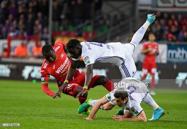 Uros Spajic defender of RSC Anderlecht nd Kara Serigne Modou Mbodji defender of RSC Anderlecht with Landry Nany Dimata forward of KV Oostende during...