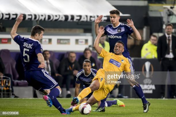 Uros Spajic of RSC Anderlecht Lorenzo Ebecilio of Apoel FC Leander Dendoncker of RSC Anderlechtduring the UEFA Europa League round of 16 match...
