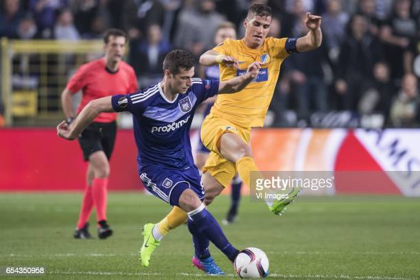 Uros Spajic of RSC Anderlecht Pieros Sotiriou of Apoel FCduring the UEFA Europa League round of 16 match between RSC Anderlecht and APOEL on March 16...