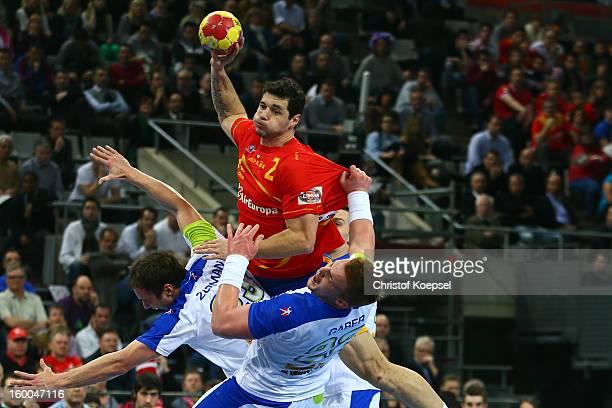 Uros Zorman of Slovenia and Matej Gaber of Slovenia defend against Alberto Entrerrios of Spain during the Men's Handball World Championship 2013 semi...