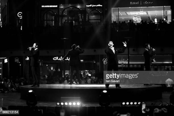 Urs Buhler Sebastien Izambard David Miller Carlos Marin and of Sebastien Izambard of Il Divo perform during the Grand Opening of The Mall of Qatar at...