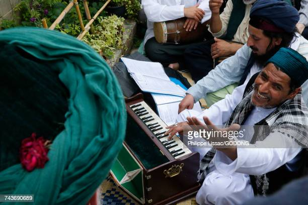Urs of Mawlana Cheikh Muhammad Nazim Adil al-Haqqani in Lefke, Cyprus. Qawali musicians performing in front of Cheikh Mehmet Adil al-Haqqani.