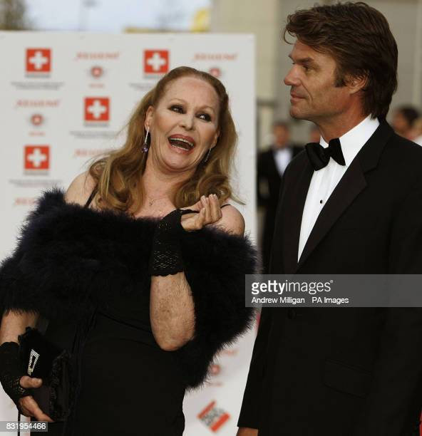 Ursula Andress and former partner Harry Hamlin after arriving in the original James Bond Aston Martin DB5 from 'Goldfinger' at the Royal Yacht...