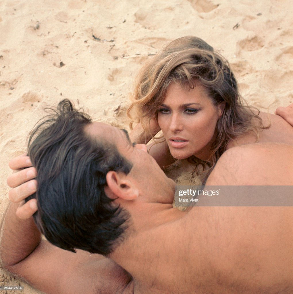 Ursula Andress and Sean Connery lay on the beach during the filming of Dr. No, the first film of the James Bond 007 series by Ian Fleming.