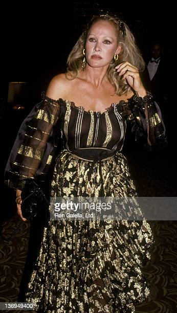 Ursula Andress attends Valentino Fashion Awards Honoring Lauren Bacall and Gregory Peck on July 3 1984 at the Century Plaza Hotel in Century City...