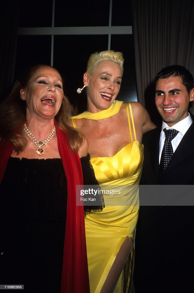 <a gi-track='captionPersonalityLinkClicked' href=/galleries/search?phrase=Ursula+Andress&family=editorial&specificpeople=213815 ng-click='$event.stopPropagation()'>Ursula Andress</a>, <a gi-track='captionPersonalityLinkClicked' href=/galleries/search?phrase=Brigitte+Nielsen&family=editorial&specificpeople=209264 ng-click='$event.stopPropagation()'>Brigitte Nielsen</a> and Mattia Dessi during The Best of 2004 28th Edition - Awards Ceremony at Pavillon Gabriel in Paris, France.