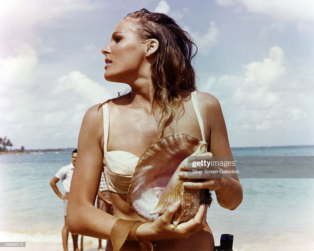 <a gi-track='captionPersonalityLinkClicked' href=/galleries/search?phrase=Ursula+Andress&family=editorial&specificpeople=213815 ng-click='$event.stopPropagation()'>Ursula Andress</a>, Swedish actress, wearing a white bikini and holding a conch shell in a publicity still issued for the film, 'Dr No', 1962. The James Bond film, directed by Terence Young (1915-1994), starred Andress as 'Honey Ryder'.