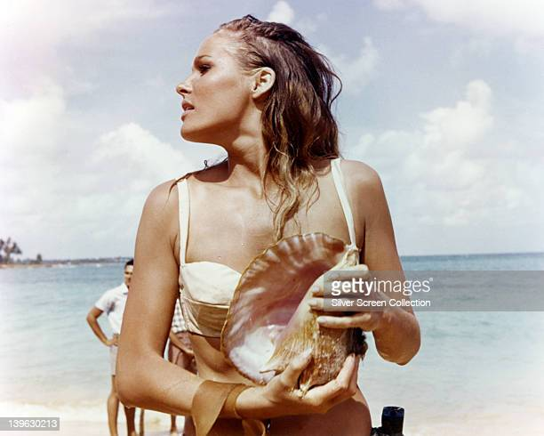 Ursula Andress Swedish actress wearing a white bikini and holding a conch shell in a publicity still issued for the film 'Dr No' 1962 The James Bond...