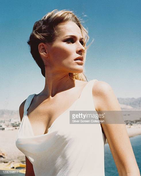 Ursula Andress Swiss actress wearing a white vesttop with a background of blue sky circa 1960