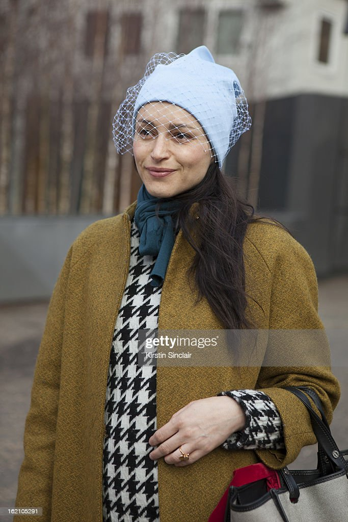 Ursula Geisselmnn wearing Jill Sander hat and a Cos jacket on day 4 of London Womens Fashion Week Autumn/Winter 2013 on February 18, 2013 in London, England.