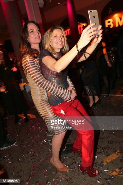 Ursula Karven and Natalia Woerner make a selfie during the BUNTE BMW Festival Night 2017 during the 67th Berlinale International Film Festival Berlin...