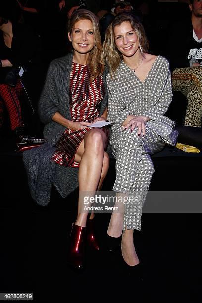 Ursula Karven and Valerie Niehaus arrive for the Dawid Tomaszewski show during MercedesBenz Fashion Week Autumn/Winter 2014/15 at Brandenburg Gate on...
