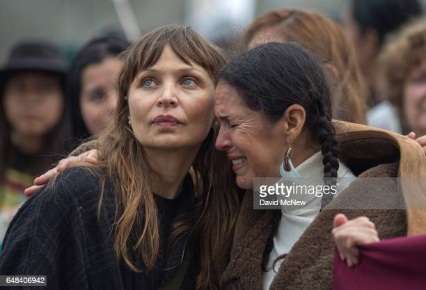 Ursula Vari comforts Teyana Visarra as women call up toward immigrants detained at the Federal Bureau of Prisons Metropolitan Detention Center who...