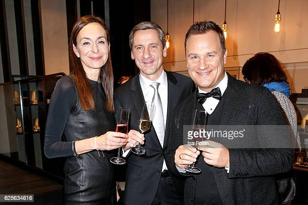 Ursula Vierkoetter DR Bernd Schroeder and Designer Guido Maria Kretschmer attend the 'Gluecksmuenz' collection launch by Guido Maria Kretschmer at...