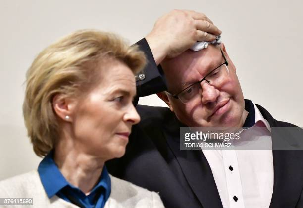 Ursula von der Leyen German Minister of Defence and German Chief of Staff and interim Finance Minister Peter Altmaier look on as they wait for German...