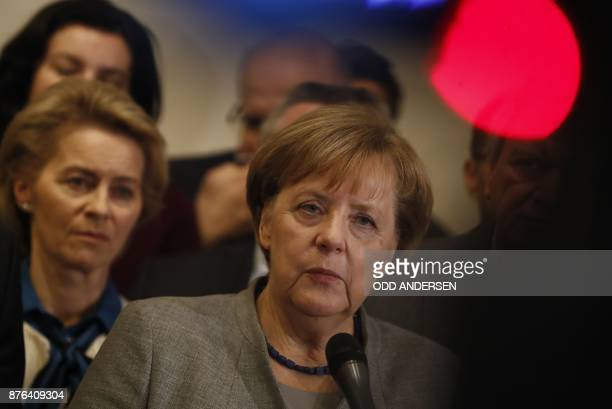 TOPSHOT Ursula von der Leyen German Minister of Defence looks on as German Chancellor and leader of the Christian Democratic Union party Angela...