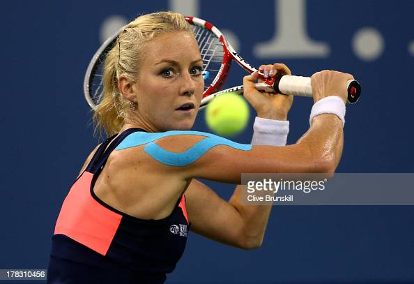 Urszula Radwanska of Poland plays a backhand during her women's singles second round match against Sloane Stephens of United States of America on Day...