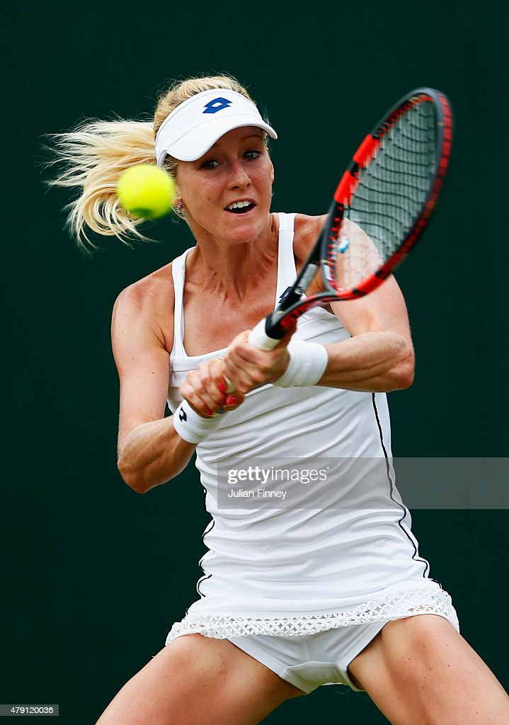 Urszula Radwanska of Poland plays a backhand in her Ladies Singles Second Round match against Samantha Stosur of Australia during day three of the Wimbledon Lawn Tennis Championships at the All England Lawn Tennis and Croquet Club on July 1, 2015 in London, England.