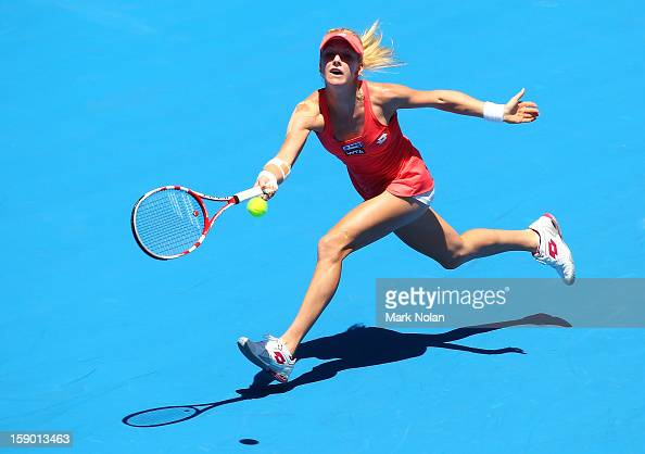 Urszula Radwanska of Poland plays a forehand in her first round match against Caroline Wozniacki of Denmark during day one of the Sydney...