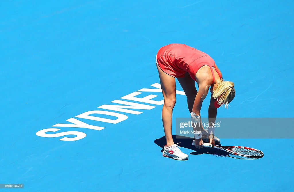 Urszula Radwanska of Poland reacts after losing a point in her first round match against Caroline Wozniacki of Denmark during day one of the Sydney International at Sydney Olympic Park Tennis Centre on January 6, 2013 in Sydney, Australia.
