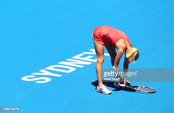 Urszula Radwanska of Poland reacts after losing a point in her first round match against Caroline Wozniacki of Denmark during day one of the Sydney...