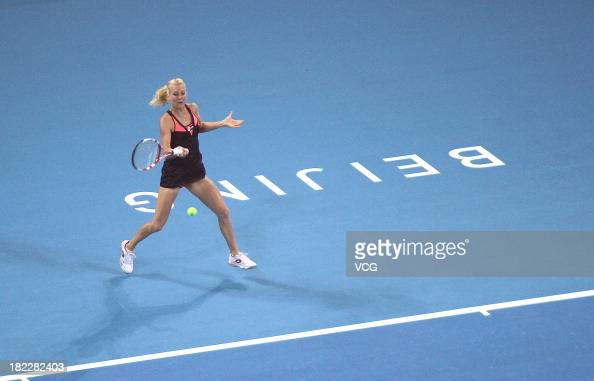 Urszula Radwanska of Poland returns a ball to Simona Halep of Romania during her women's singles first round match of the 2013 China Open at National...