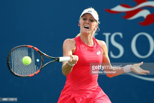 Urszula Radwanska of Poland returns a shot against Magda Linette of Poland during their Woman's Singles First Round match on Day One of the 2015 US...