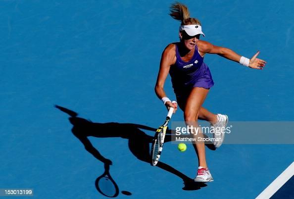 Urszula Radwanska of Poland returns a shot to Romina Oprandi of Switzerland during the China Open at the China National Tennis Center on September 29...