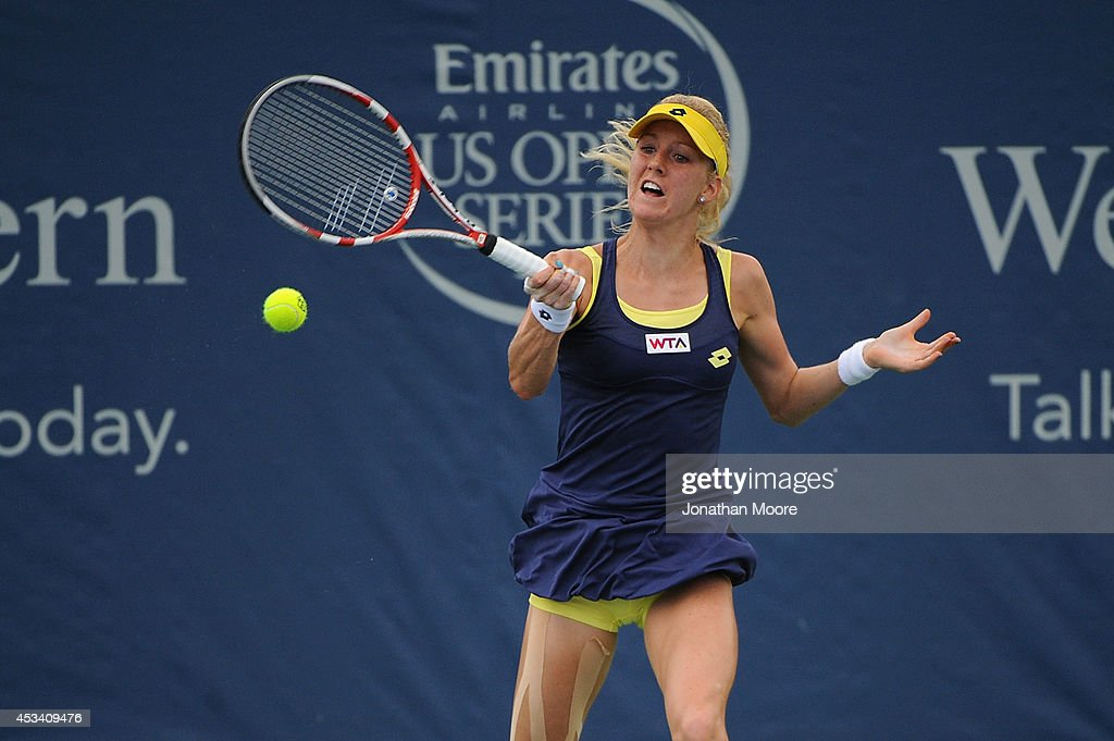 Urszula Radwanska of Poland returns to Karin Knapp of Italy during a match on day 1 of the Western and Southern Open on August 9 2014 in Cincinnati...