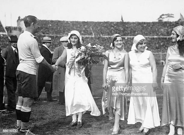 Uruguay captain Jose Nasazzi receives some flowers during the prematch formalities prior to the FIFA World Cup SemiFinal between Uruguay and...