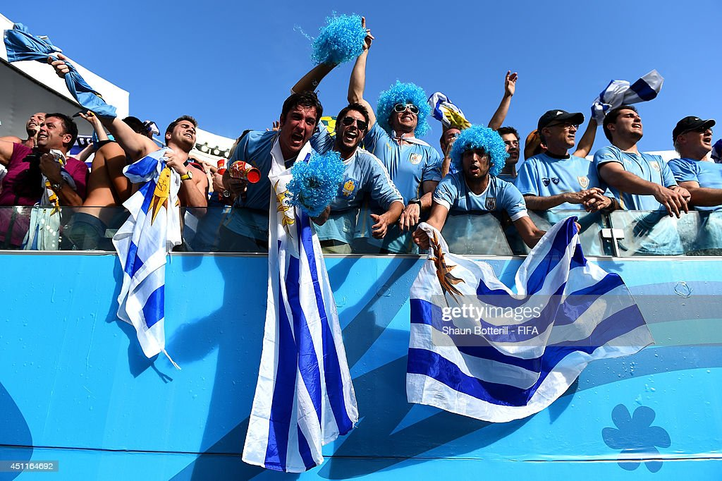 Uruguay fans celebrate the win after the ...
