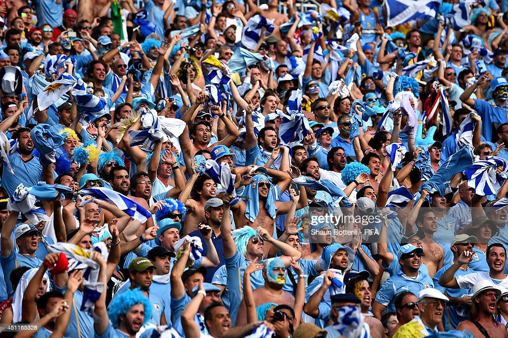 Uruguay fans celebrate their team's first goal during the 2014 FIFA World Cup Brazil Group D match between Italy and Uruguay at Estadio das Dunas on June 24, 2014 in Natal, Brazil.