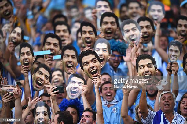 Uruguay fans hold up and wear Luis Suarez masks ahead of the 2014 FIFA World Cup Brazil round of 16 match between Colombia and Uruguay at Maracana on...