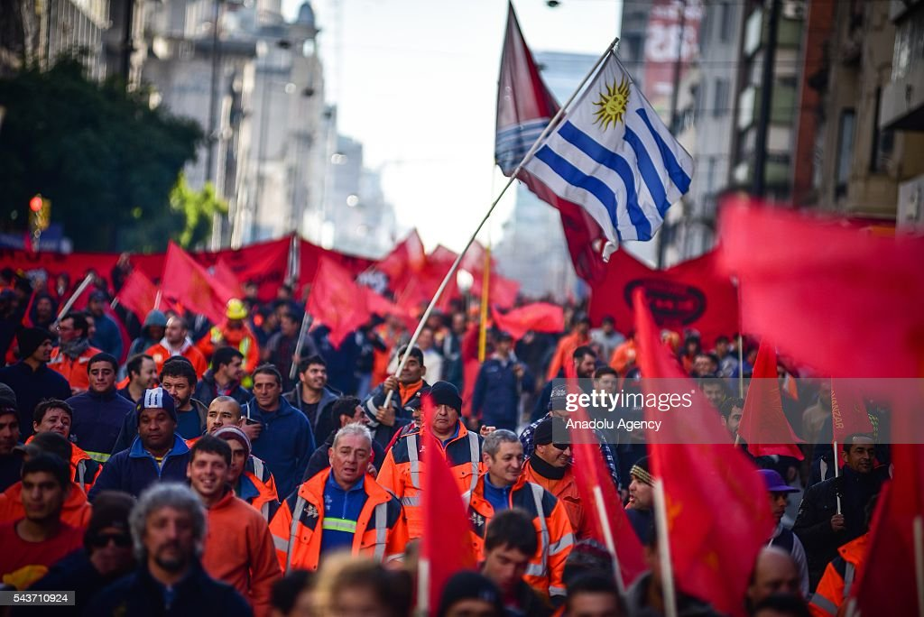 Uruguay flag flapping in the march against the economic policies in Montevideo on June 29, 2016 in Montevideo. The PIT-CNT (the only organization of unionized workers of Uruguay) today made a partial strike and marched to front the Ministry of Economy of Uruguay.