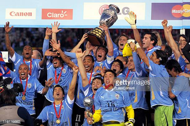 Uruguay National team players celebrate with the trophy their victory of the Copa America 2011 against Paraguay at Antonio Vespucio Liberti Stadium...