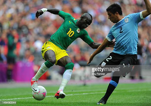 Uruguay player Ramon Aria is beaten to the ball by Sadio Mane during the Men's Football first round Group A Match between Senegal and Uruguay on Day...