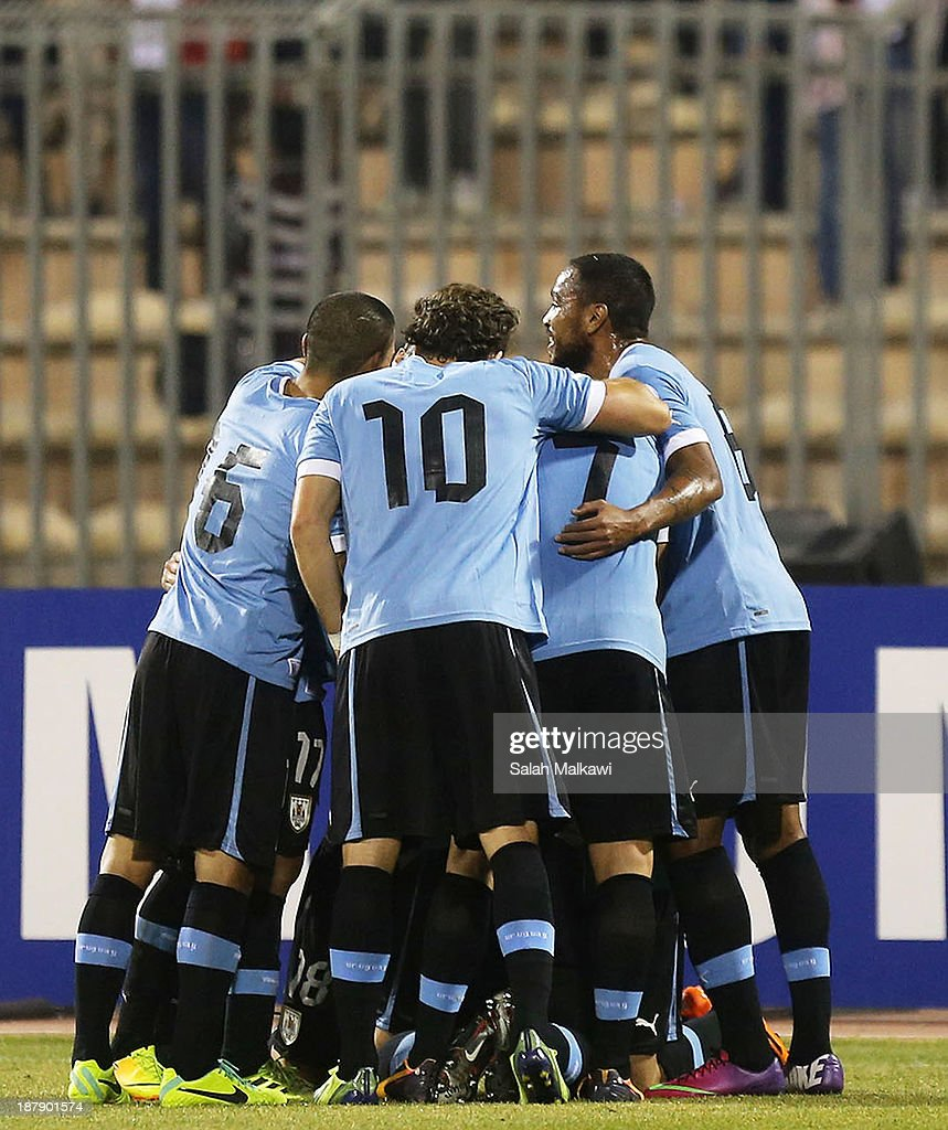 Uruguay players celebrate victory during the FIFA 2014 World Cup Qualifier: Intercontinental Play-off First Leg between Jordan and Uruguay on November 13, 2013 in Amman, Jordan.