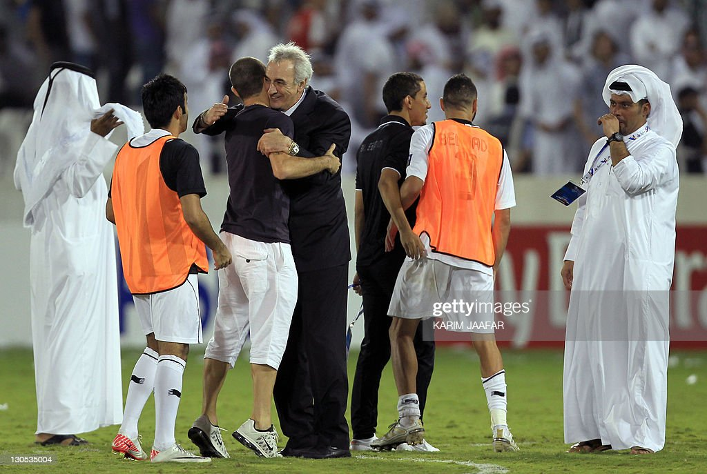 Uruguayan coach Jorge Fossati celebrates with his al-Sadd team players after the match against South Korea's Suwon Samsung Bluewings during their semi-final football match in the AFC Champions League in Doha, on October 26, 2011. Suwon Samsung Bluewings won the match 1-0. AFP PHOTO/KARIM JAAFAR